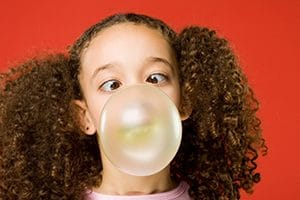 little girl blow bubble gum bubble