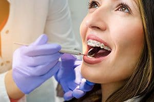 women getting her braces examined